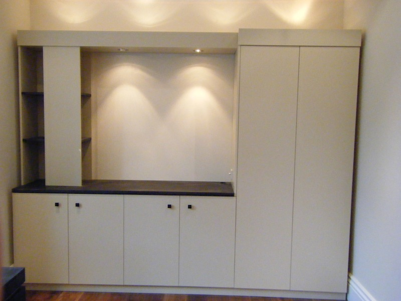 Another wall of cupboards and shelves, showing the integral lighting