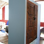 Coat cupboard and shoe drawers side, incorporating clients' carved doors.