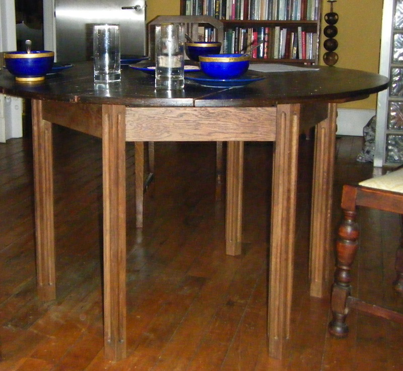 A new table leg frame for an old fold-up campaign table, antiqued to match the old table top.