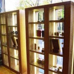 Two units each h: 2200 mm x w: 1600 mm x d: 450 mm. Cherry veneered MDF, adjustable shelves, integral lighting panels, with lockable glass doors. Co-design, manufacture of woodwork, electrics, glasswork.