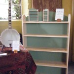 Prototype stacking pine bookshelves, shown with model ones at exhibition.