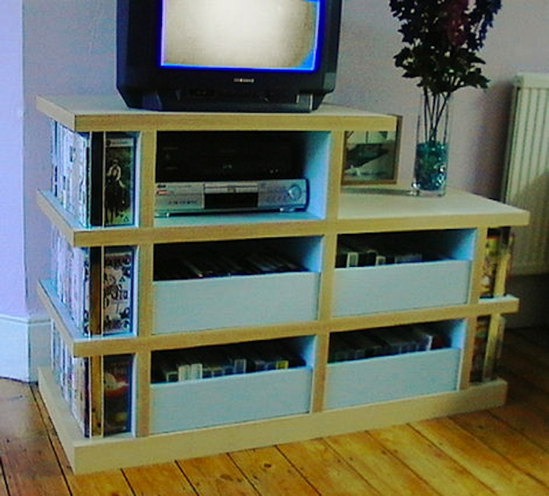 Unit designed to match the coffee table. Four drawers for videos.
